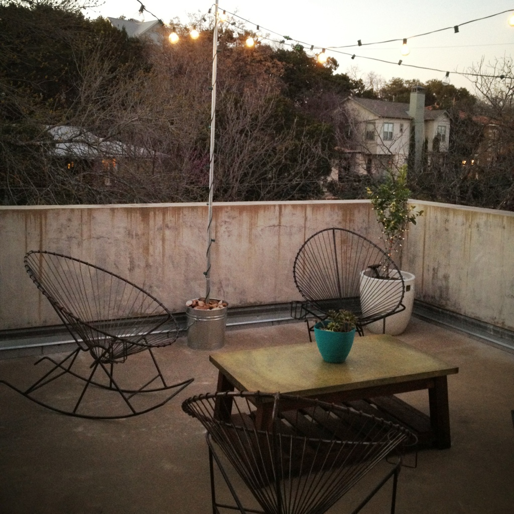 Acapulco Chairs and Globe Lights make a pretty patio