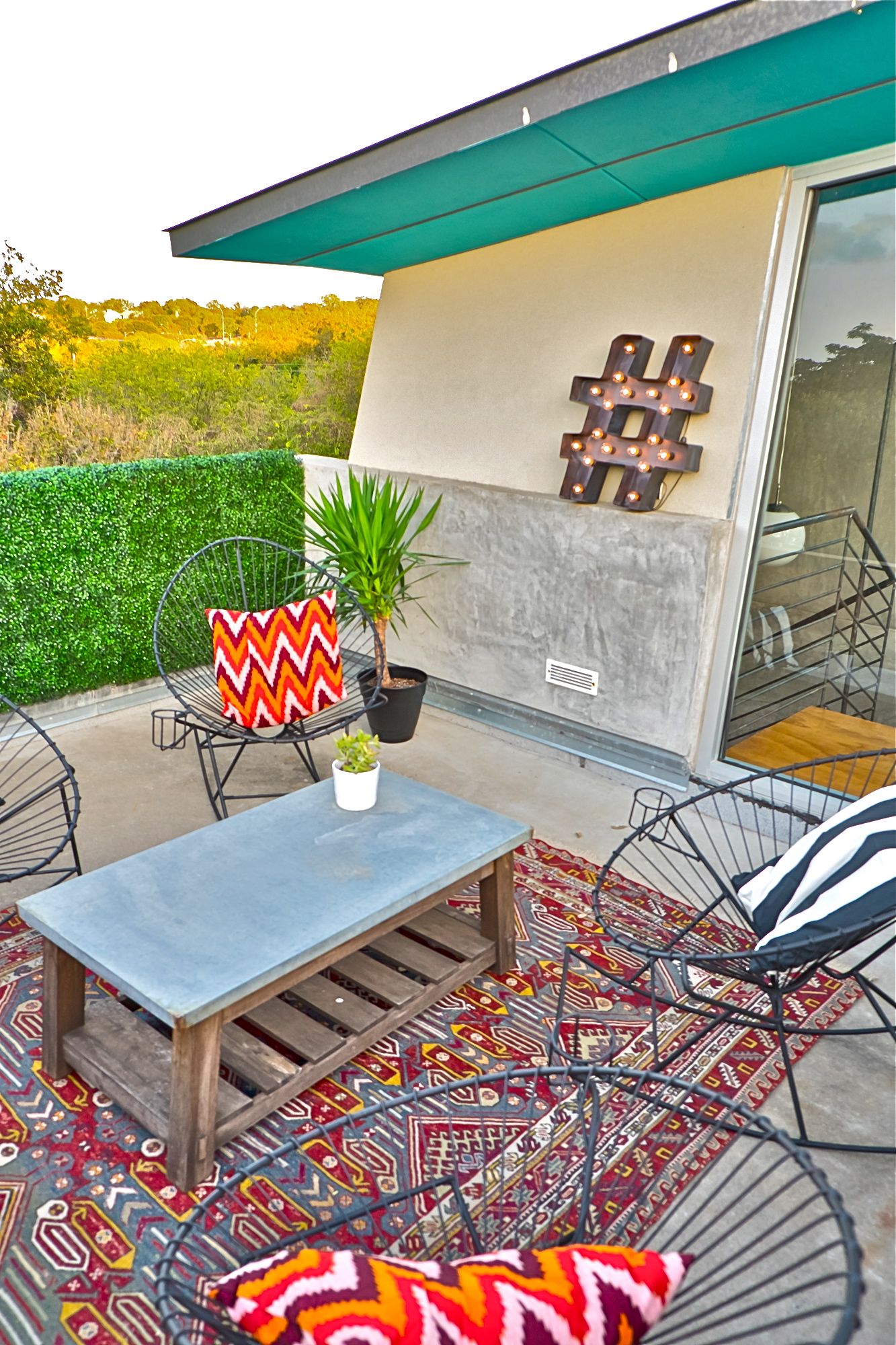 Acapulco chair on patio - Hashtag Sign